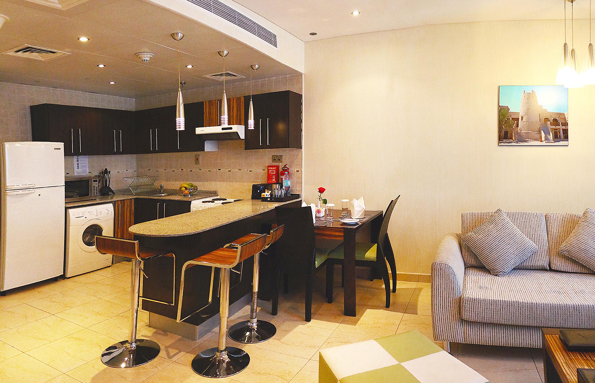Image CPHA_1BR_Standard_Kitchen_Dining_Area.jpg